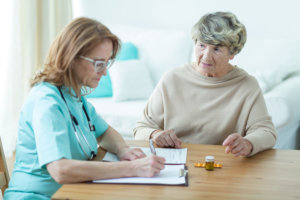caregiver assessing her patient's health